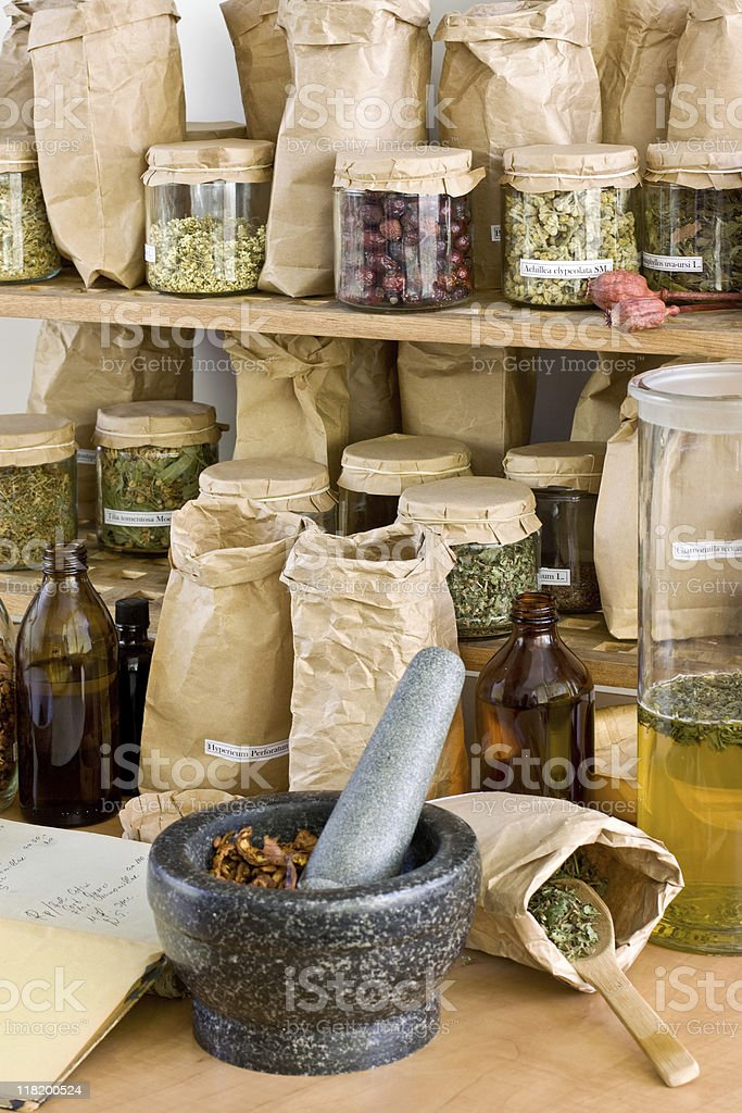 Different types of herbs on shelves stock photo