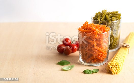 istock Different types of Italian pasta with vegetables on the table 1009984188