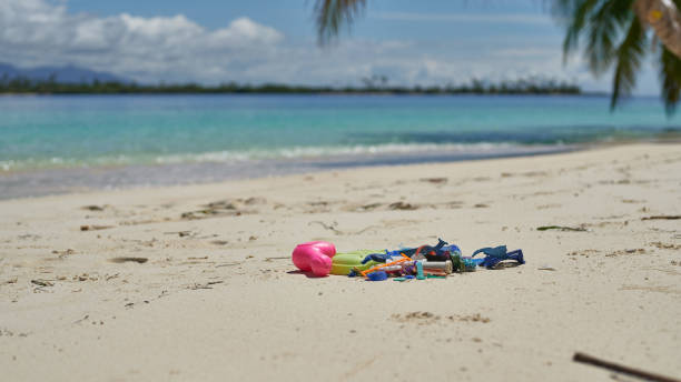 Different types of plastic garbage found on paradise uninhabited islands stock photo