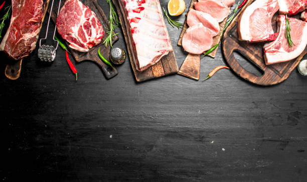 different types of raw pork meat and beef with herb and spices. - meat imagens e fotografias de stock