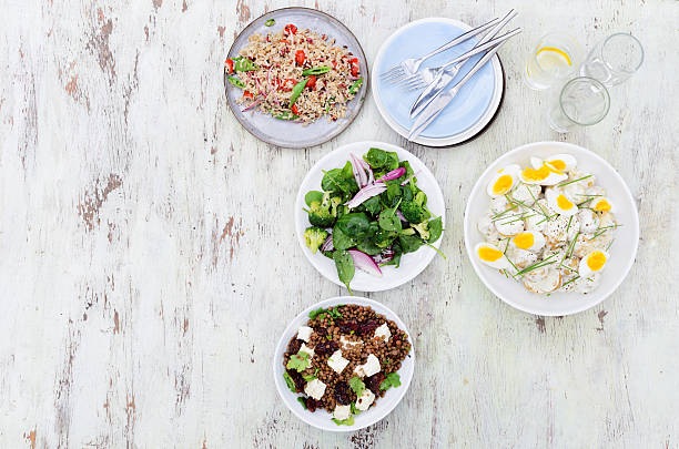 verschiedene salate für den empfang von gästen - partysalate stock-fotos und bilder