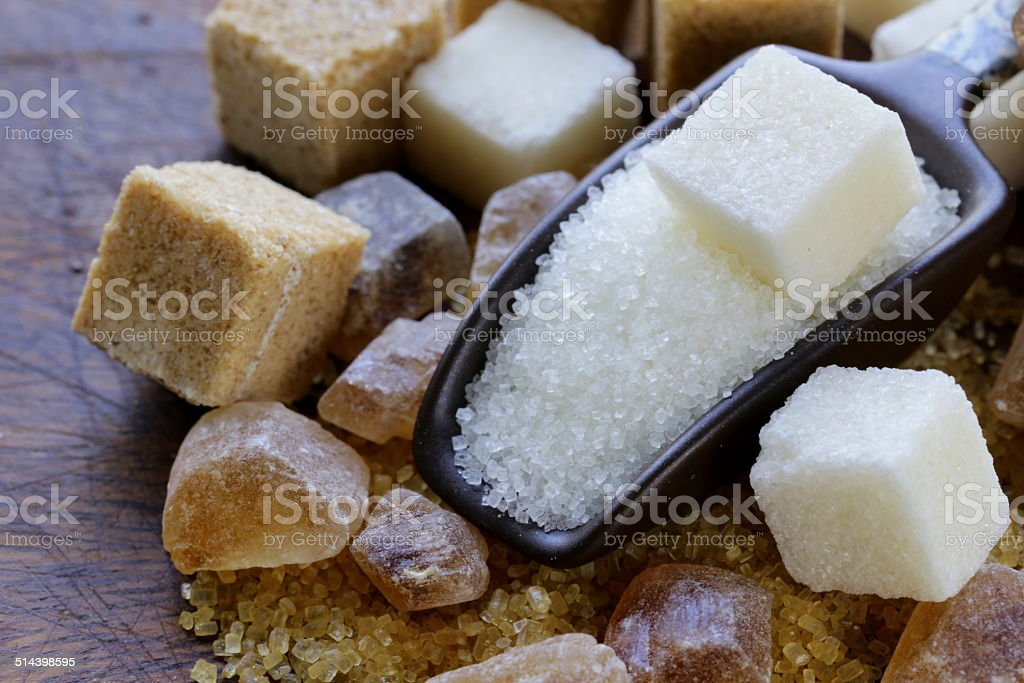 different types of sugar - brown, white and refined sugar stock photo