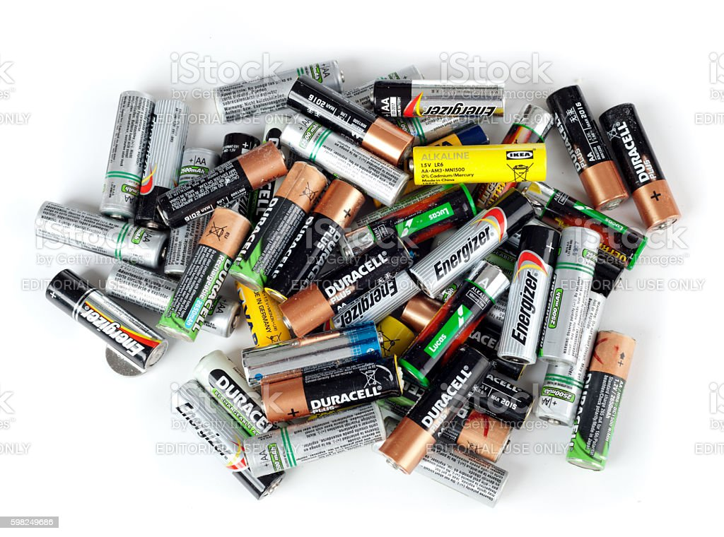 Different types of used batteries ready for recycling bildbanksfoto