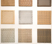 different types of wickers - nine square pieces on the wall