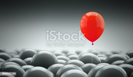 Different, unique and standing out of the crowd concept. A red baloon is different and above the other gray ones, representing the individuality in the masses.