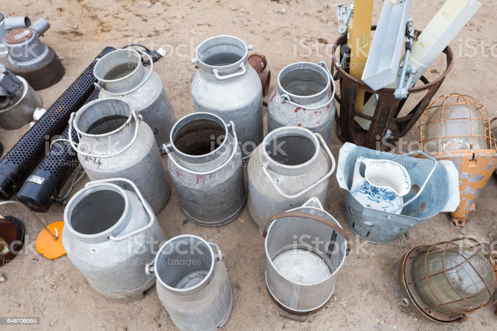 Different Used Water Cans on Flea Market stock photo