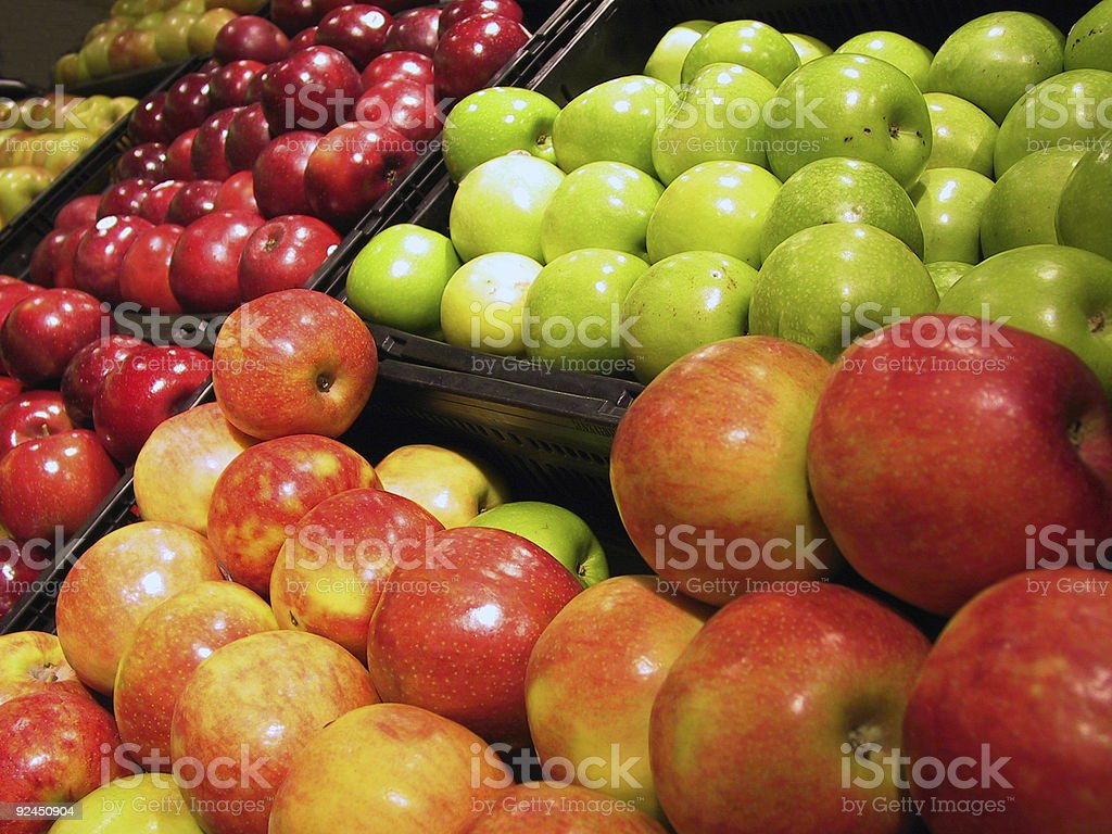 Different varieties of apples at a market stock photo