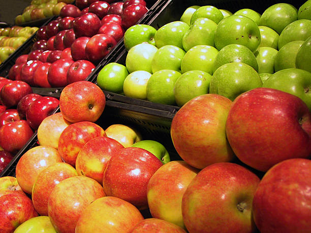 Different varieties of apples at a market Different varieties of apples on display for sale.   red delicious apple stock pictures, royalty-free photos & images