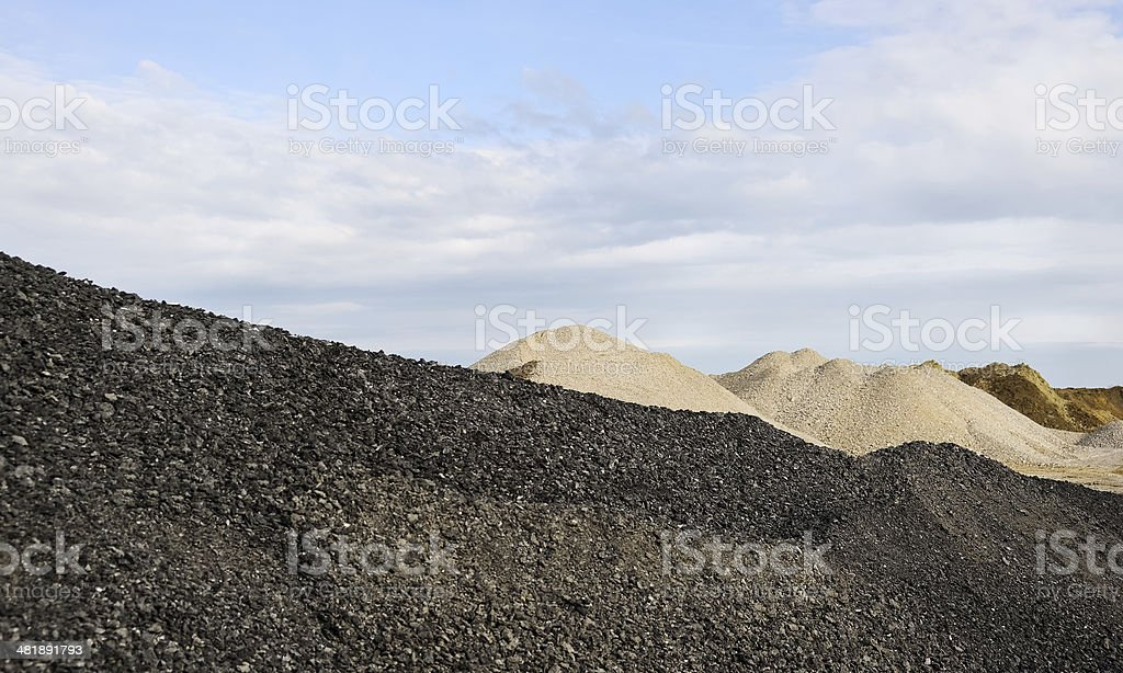 Different varieties of gravel and stone on construction camp stock photo
