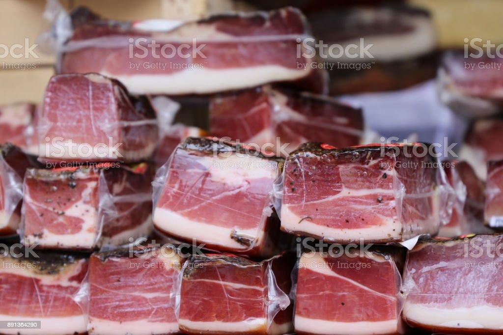Different varieties of raw ham stock photo