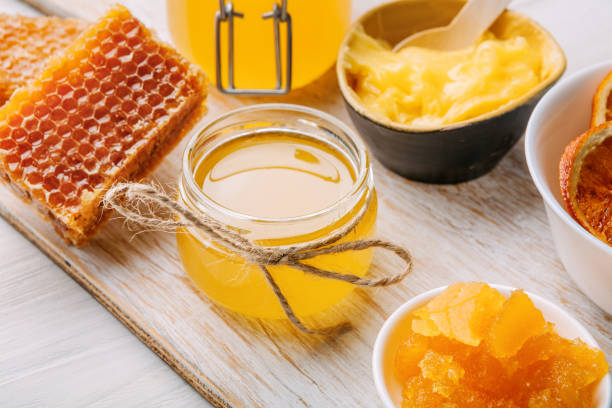 different varieties of sweet golden fresh honey - sweeteners stock photos and pictures