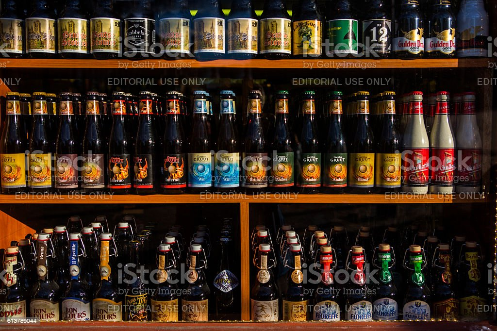 different variety of belgian beers  on store at ghent belgium stock photo