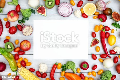 istock Different vegetables and fruits on a wooden background top view. 857732428
