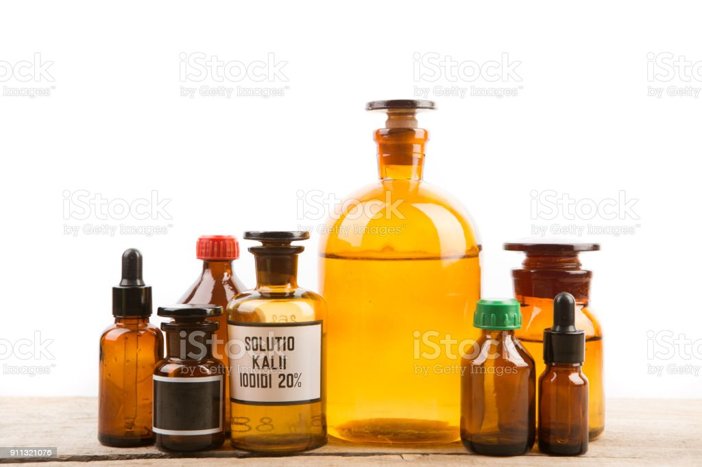 Different vintage pharmacy bottles isolated on white stock photo