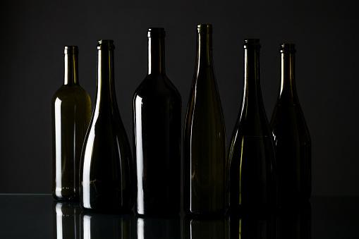 Different wine bottles on black background