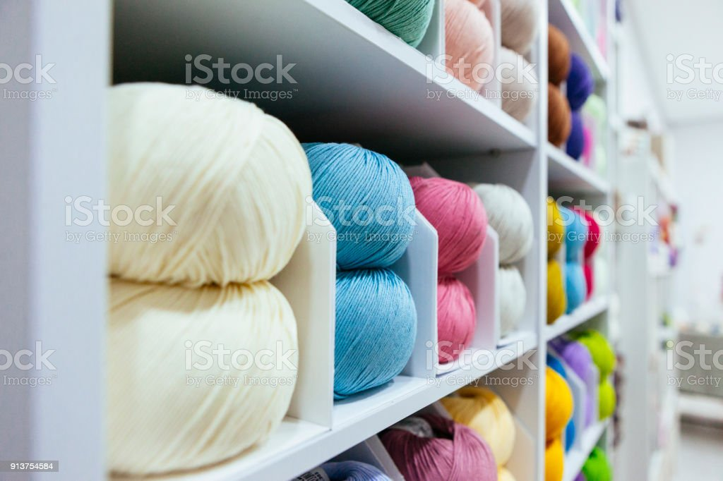 different wool yarns organized by color stock photo