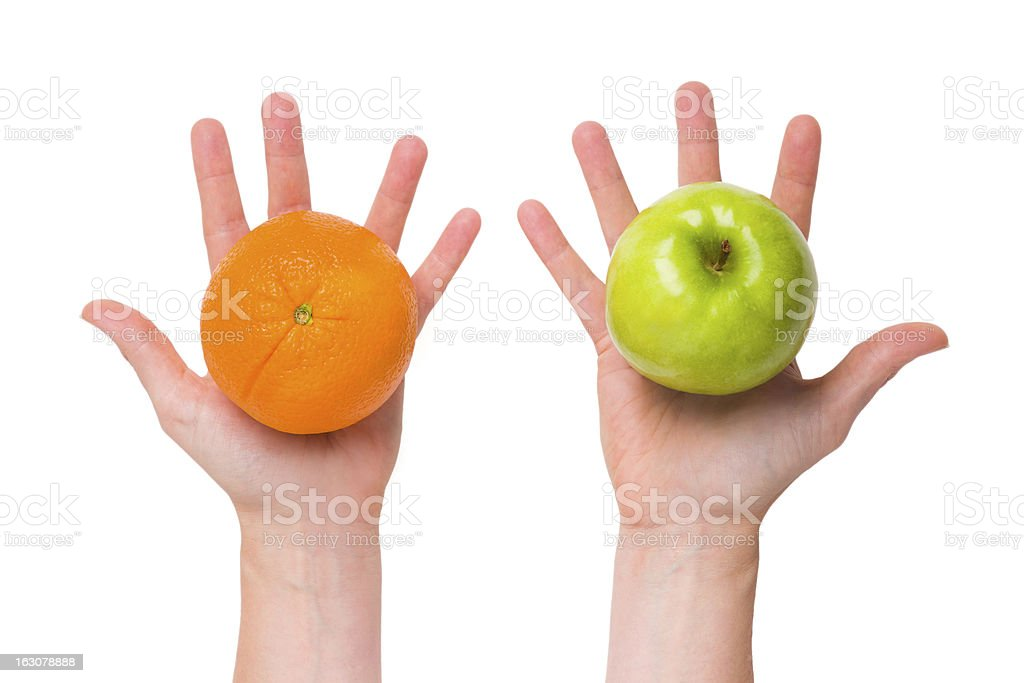 Differentiate apples from oranges stock photo