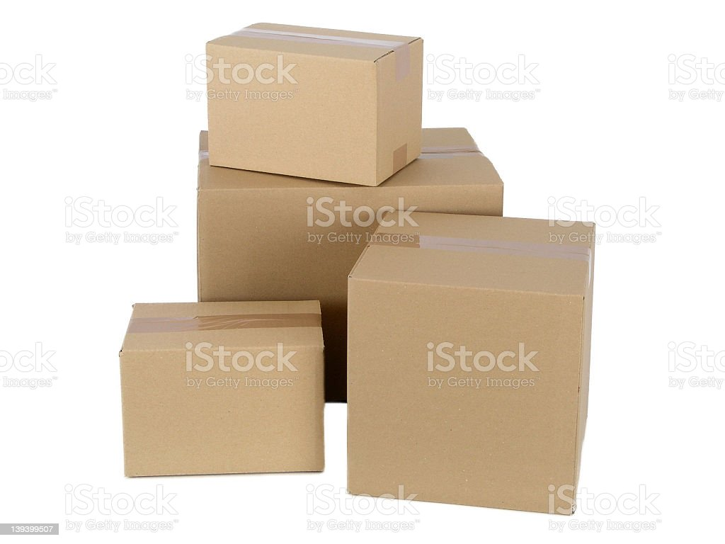 Different-sized cardboard packages on a white surface royalty-free stock photo