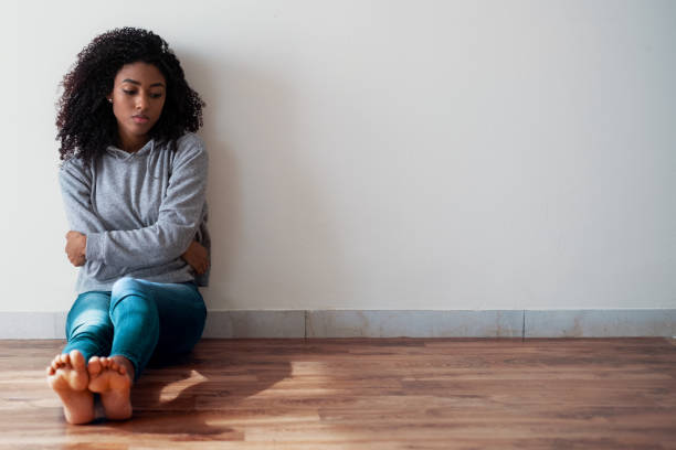 Difficult black teenage girl feeling sad and anxious stock photo