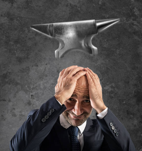 Difficult career in business with falling anvil Concept of difficult career in business with falling anvil anvil stock pictures, royalty-free photos & images