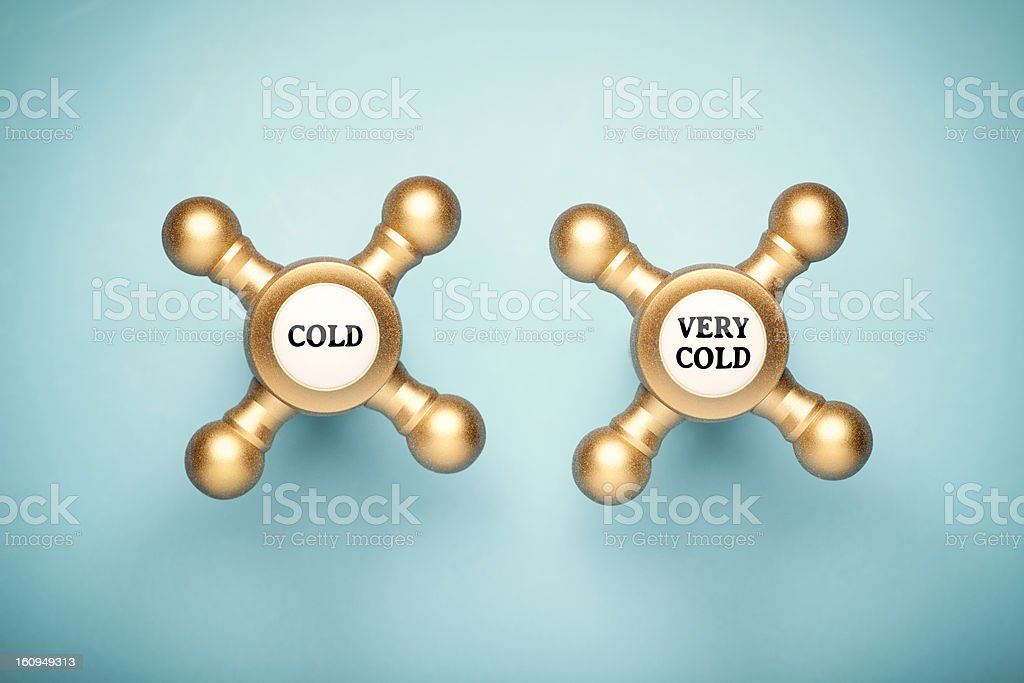 Conceptual photography of two golden retro faucets.