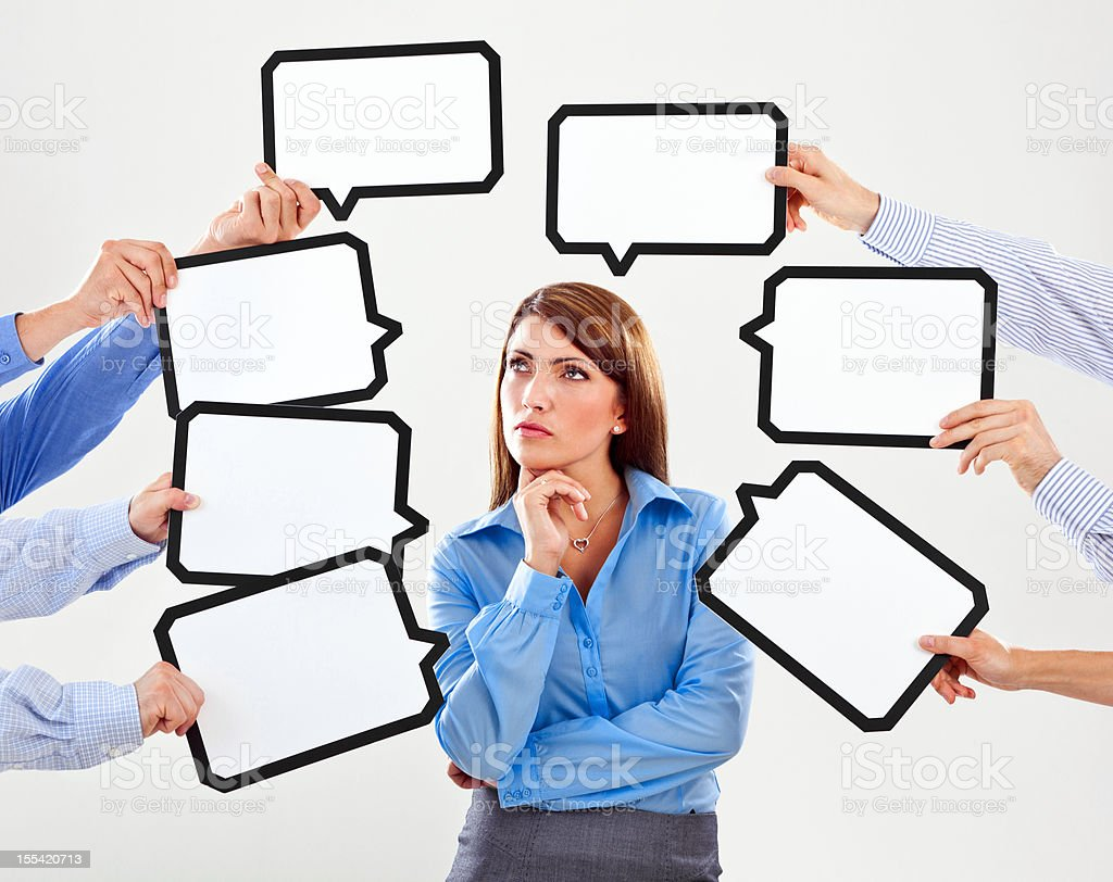 Difficult choice Attractive businesswoman surrounded by many speech bubbles with copyspace. 25-29 Years Stock Photo