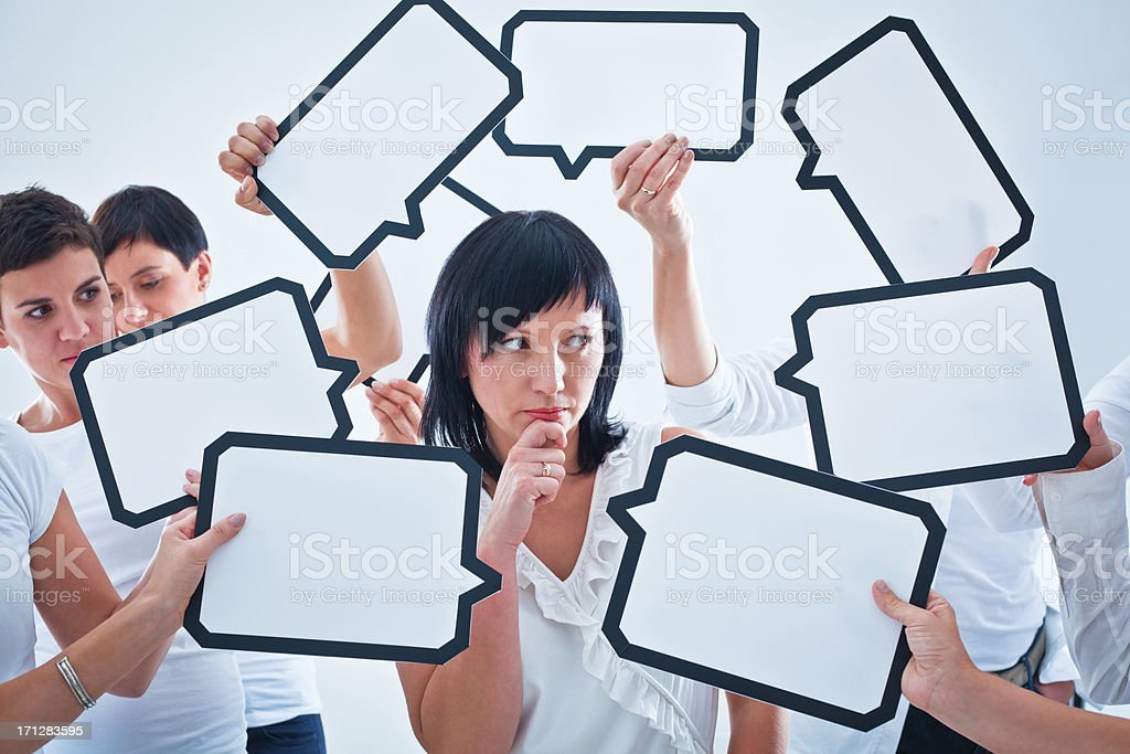 Difficult choice Cofused woman surrounded by many speech bubbles with copyspace. 30-34 Years Stock Photo