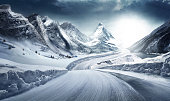 istock Difficult conditions on snowy road. 1246980976