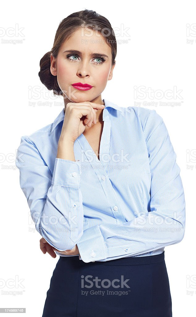 Difficult decision Portrait of worried businesswoman standing against white background with hand on chin. 20-24 Years Stock Photo