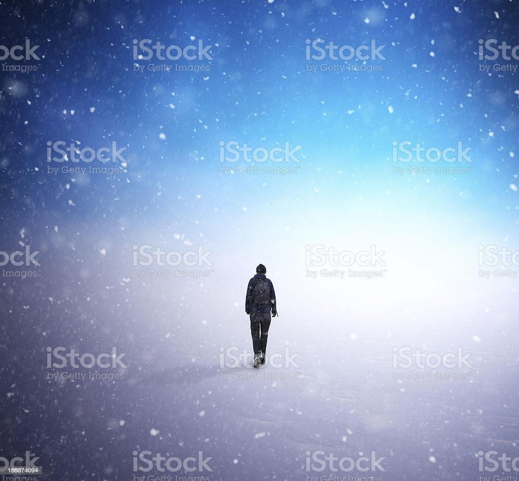 Diffuse image of man walking through snow royalty-free stock photo