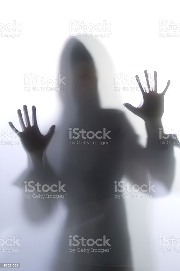 Diffused Silhouette of a womans body threw frosted glass royalty-free stock photo