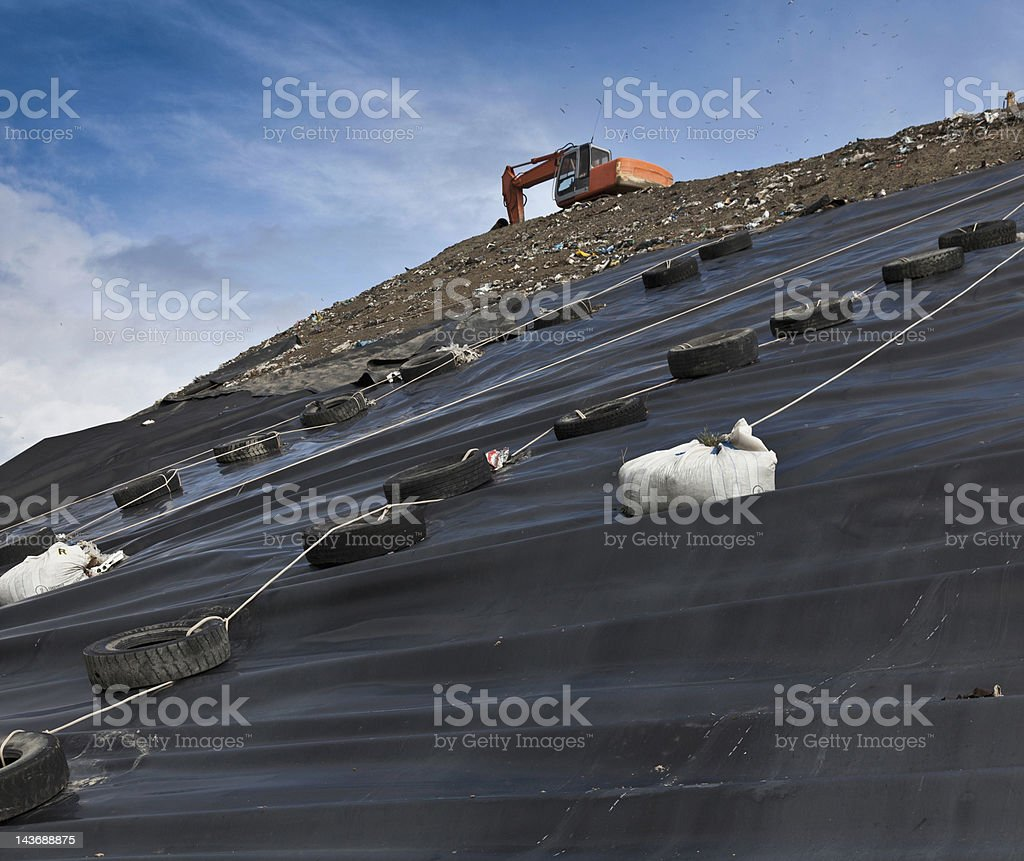 Digger at garbage collection center stock photo