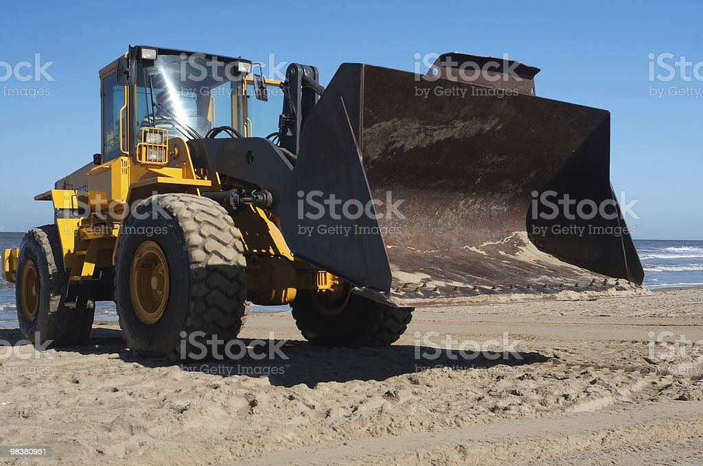 Digger at the beach royalty-free stock photo