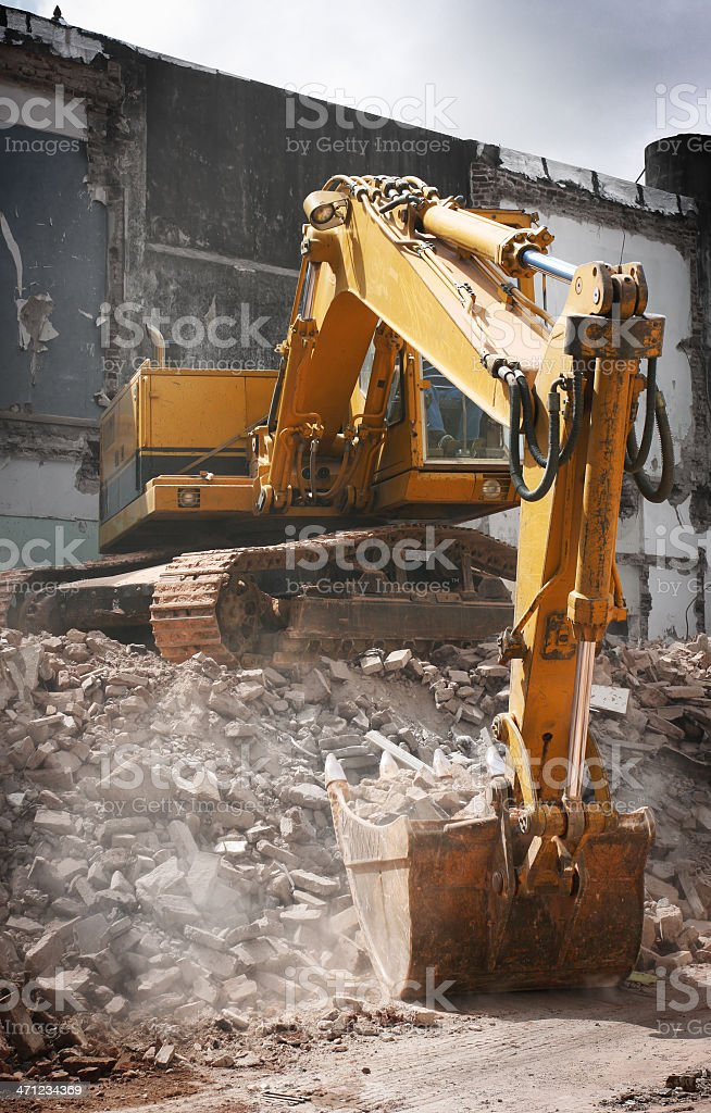 Digger Clearing Rubble stock photo