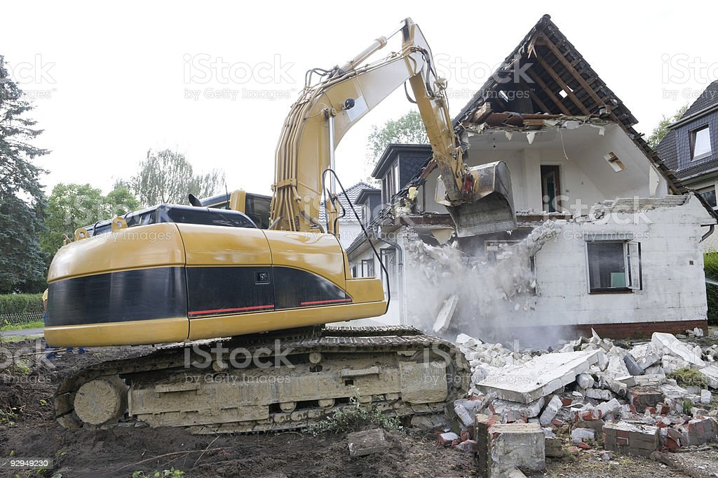 Digger Demolishing House stock photo