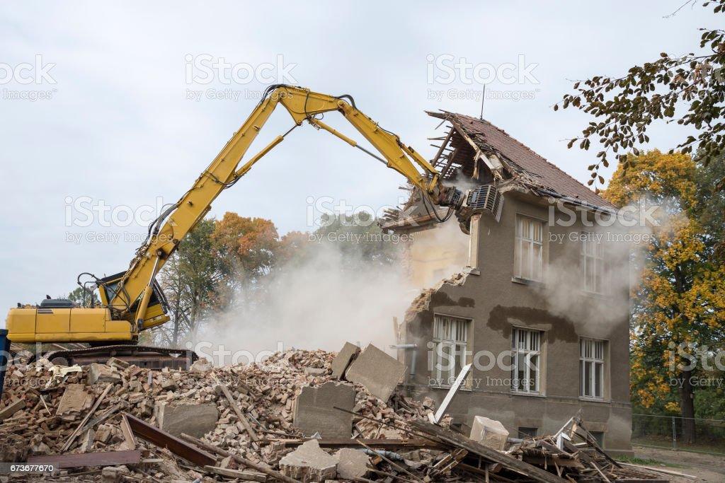 digger demolishing houses stock photo