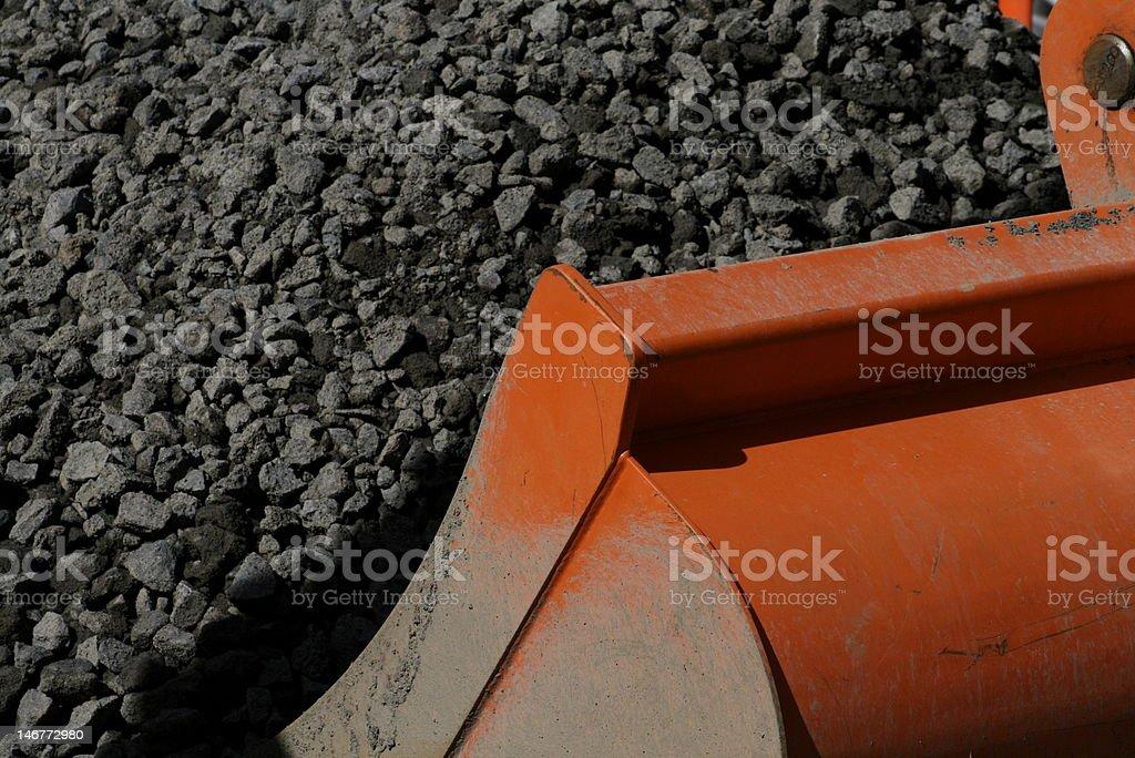 Digger digging gravel royalty-free stock photo