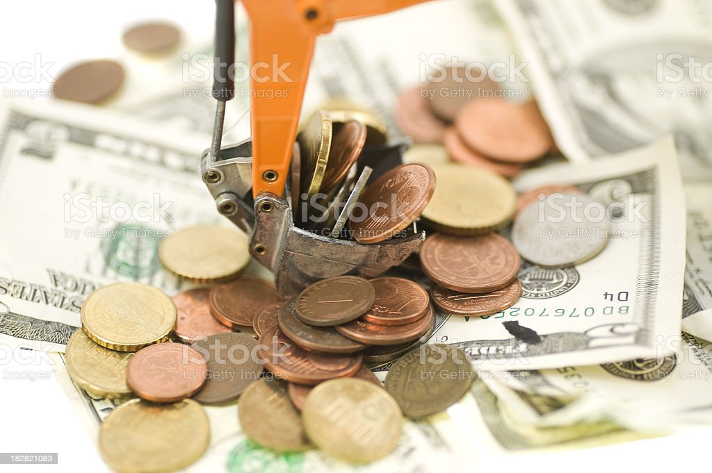 digger with coins macro image royalty-free stock photo