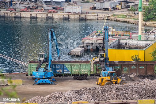 istock Diggers load a railway carriage 596039948