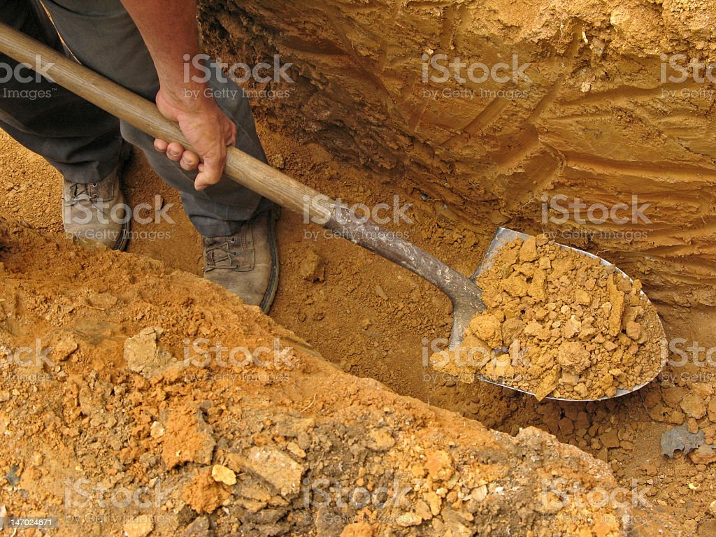Digging a trench stock photo