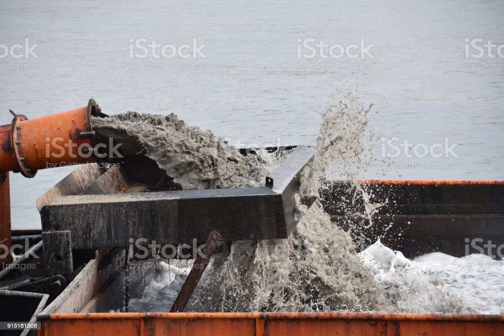 Digging boat  To deepen the entrance to the port stock photo