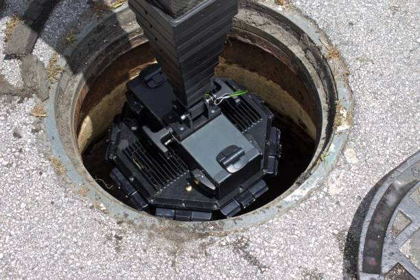 Digital 3D manhole inspection camera Inspection camera being lowered into sewer manhole for 3d digital examination sewer stock pictures, royalty-free photos & images