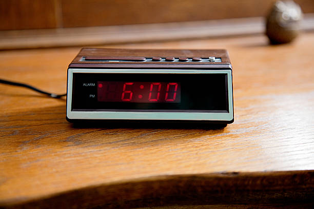 digital alarm clock showing 6.00am - alarm stock photos and pictures