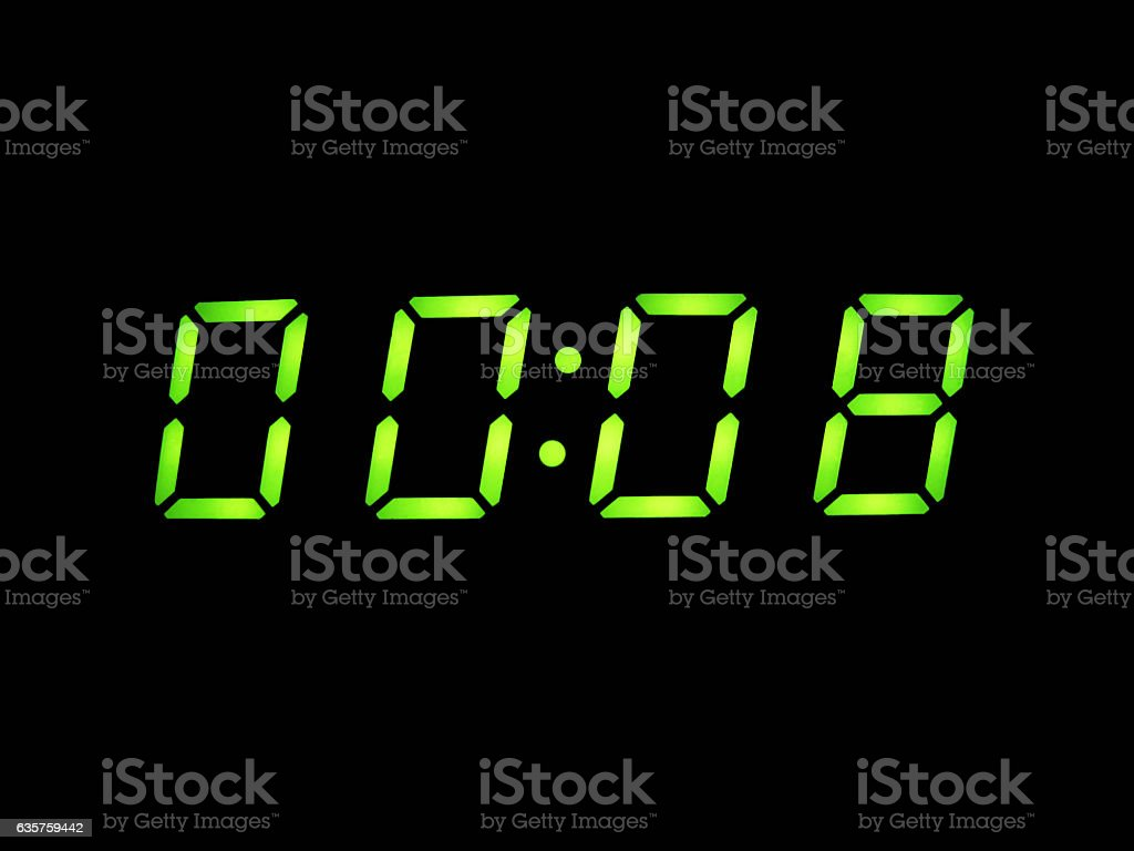 digital alarm clock with green digits stock photo