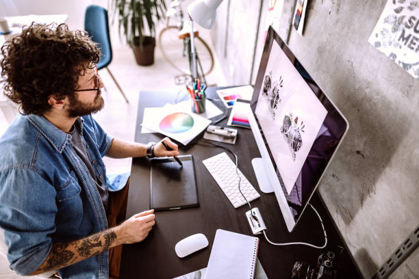 Digital Artist Working At Home stock photo