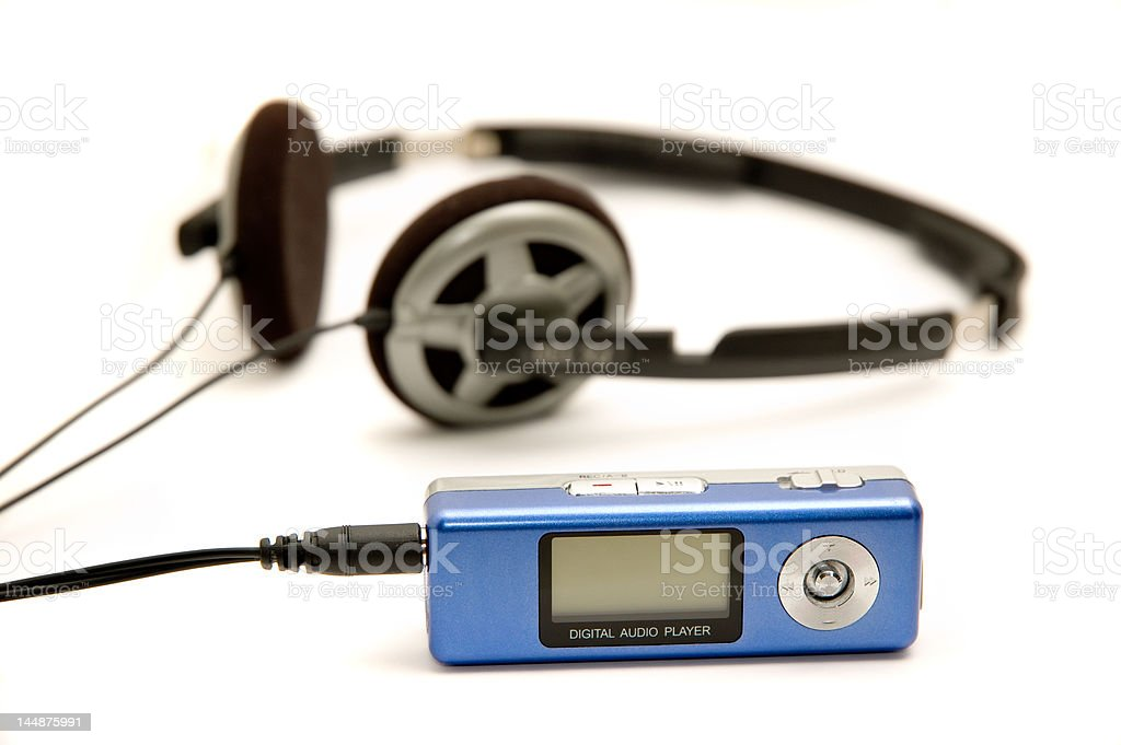 Digital audio player with headphones royalty-free stock photo