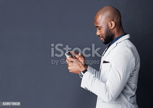 Studio shot of a businessman using a digital tablet against a gray background