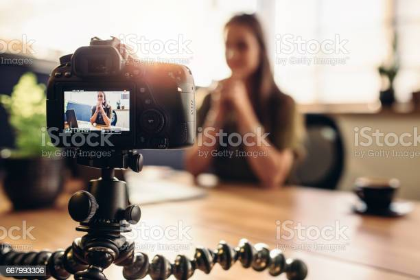 Digital camera on flexible tripod recording a video of woman at desk picture id667993306?b=1&k=6&m=667993306&s=612x612&h=onrmxvuofzhafbuuwqgcsod3wwz9vxde ldermmuyro=