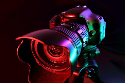 Digital camera illuminated with multicolor light.