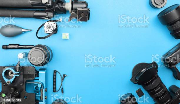 Digital camera with lenses and equipment of the professional on blue picture id1050183738?b=1&k=6&m=1050183738&s=612x612&h=egnzvu7sritfpajq4pfefrb0whtpqguswzhreu9wkie=